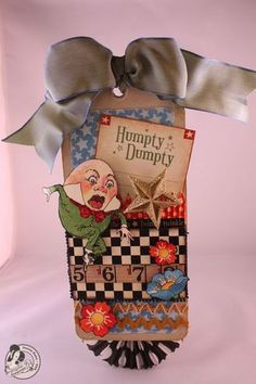 This tag by Graphic 45 used products from the Mother Goose collection.
