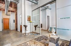 Robert Watson Lofts-363-369 Sorauren Ave #217 | Rare bright North East 2 bedroom + 2 bath corner loft with walk-out to private balcony! Features include original exposed brick walls, high concrete ceilings & polished concrete floors.1 Parking included. | More info here: torontolofts.ca/robert-watson-lofts-363-lofts-for-sale/363-sorauren-ave-217