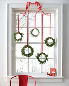 The decor serves double duty as indoor and outdoor cheer. Depending on what type of windows you have, easiest way to make this work is probably to use an inexpensive tension rod like in the photo above (these are $9.99 at Bed Bath & Beyond). To make wreaths out of herbs, the extra greens from your tree, or whatever other greenery you have around, follow this tutorial.