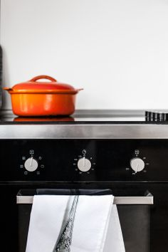 black stove, orange pot