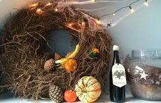 Home Tour: Alexa's Skeleton Party. Knotted winter wreath with Autumn vegetable, cobwebs & twinkle lights. Creating a decaying sense of luxury. #hometour #wreath #autumn #gourds #decanter #cobwebs #halloween
