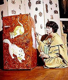 Leonor Fini painting her refrigerator | 'To her, it was a Chinese lacquer box on which to draw cats.' http://www.thegreatcat.org/the-cat-in-art-and-photos-2/cats-in-art-20th-century/leonor-fini-1907-1996-argentine/