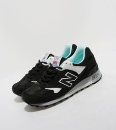This 577, from British brand New Balance, is one of the brands trainers which are entirely hand-made in England in the countries only domestic trainer factory. It is presented in premium suede and breathable mesh, both in dark grey and features white tumbled leather accents, mint coloured inner and the famous New Balance branding on the side in a speckled reflective material. The sole includes the brands Encap foam technology with a branded heel stabiliser.   - Grey/Ivory/Mint
