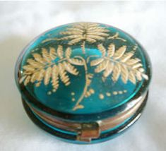 Antique European etched glass patch or pill box in a diserable aqua marine color, MOSER Bohemian glass and brass. The lid is accented by a etched fern and highlighted with gold gilt and enameled accents. The hinged lid closes with a snap, Circa 1850-1899