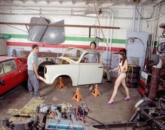 """Liz Cohen's (2005 Visual Arts) """"BODYWORK"""" is a combination performance and sculpture project in which Cohen transforms an aging East German Trabant into an American El Camino low-rider, and herself into a car customizer and bikini model."""