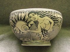 This ceramic bowl from Tzintzuntzan Michoacan Mexico is decorated with the rising sun and a smiling mermaid. The artist is Angelica Morales Gamez. Photo by Karen Elwell