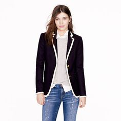 Tipped hacking jacket in double-serge wool, from jcrew.  In picking blazers, if you want to keep a more butch feel, look for squared edges as seen here.  Avoid rounded corners like on this jacket: http://www.jcrew.com/womens_category/blazers/schoolboy/PRDOVR~97548/97548.jsp