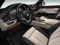 The 2015 BMW X6 xDrive35i shown with Ivory White/Black Bi-Color Interior Design Package.