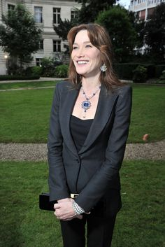 Carla Bruni in a Bulgari High Jewelry necklace centered with a 43 carat blue sapphire.