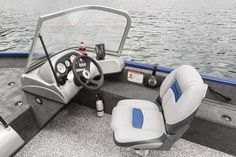 NEW Lowrance® Elite-3x COLOR fishfinder w/bright, backlit 240x360-pixel LED display & dual-freq. 83/200 kHz transducer     NEW sport steering wheel     Port & starboard fibreglass-reinforced moulded consoles w/tempered safety-glass walk-thru windshield     Passenger console w/glovebox & built-in drink holder     Driver side drink holder     Illuminated speedometer, tachometer & fuel gauge     Toggle switches     Black Metallic instrument & switch panel     Mercury® control box