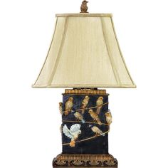 Cast a stylish glow over your bedside or favorite reading nook with this eye-catching table lamp, featuring a perching birds motif and flaring fabric shade. ...