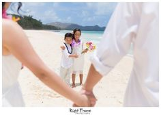 www.rightframe.net -  Beautiful Destination Wedding Vow Renewal in Oahu, Hawaii,  Beach, photography, photographer, weddings, wedding, photos, bride , groom, hawaiian, romantic, ideas, idea, pose, poses, couple, lei, clothes, dress, vows, ceremony, blue, white, wreath, family, fun, Anniversary, photo, pictures, renewing, tips, ocean, Waimanalo, Bellows,