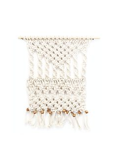 Adorn your living space with this beautiful macrame wall hanging.