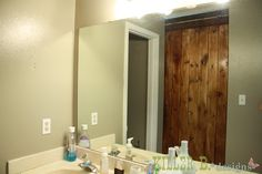 How to make your own sliding barn door with hardware from Lowes.