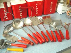 The Kitschy Collectors favorites in vintage kitchen collectibles.  Visit my blog http://cdiannezweig.blogspot.com/ and my site http://iantiqueonline.ning.com/    bakelite* red color utensils by ilovehesby, via Flickr