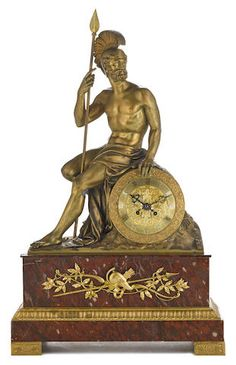 A French gilt bronze and rouge marble figural mantel clock second half 19th century