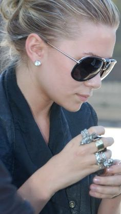 I NEED these sunglasses. Ashley Olsen