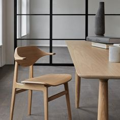 Buffalo is the latest edition to the family of dining chairs based on the proven NY11 frame. The back is made from multiple layers of oak veneer forming the characteristic buffalo horn shape. The back and armrest gently curves around the body and provides superior comfort.  Brand: Norr11 | Designer: Kristian Sofus Hansen Nordic Furniture, Danish Furniture, Small Furniture, Furniture Design, Minimalist Furniture, Furniture Chairs, Office Furniture, Dining Chairs, Dining Table
