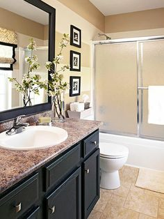 """Love the """"fresh"""" look - and the black photo frames, it's not the stereotypical bathroom look. Everything looks clean and fresh."""