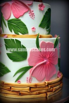 I want someone to make me this. Jennifer Luau Hibiscus Cake, love the bamboo. with turquoise