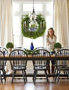 Table set for 10, large windows, tall ceilings, beautiful curtains. Love table and chairs.