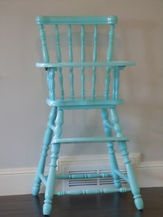 spray painted highchair....just bought a wooden highchair just like this for $4 for the new baby! :)