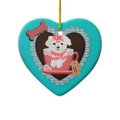 Teacup Baby Heart Ornament, Maltese. Graphic Design featuring a tiny maltese puppy hanging outside the rim of a lace trimmed teacup. Rose, tag and bone decorations. Color is Coral/teal and chocolate brown. Year round maltese ornament. #maltese #teacup #heart #ornament #MargaretNewcomb Visit my Zazzle Store at: http://www.zazzle.com/serenitygardens?rf=238170457442240176