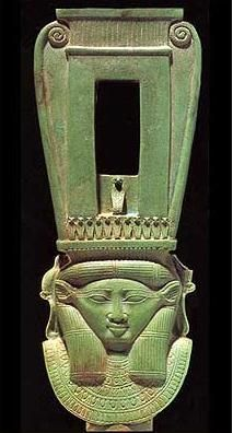 Enclosed faience sistrum with head of Hathor. A sistrum is a musical instrument of the percussion family, chiefly associated with ancient Iraq and Egypt.
