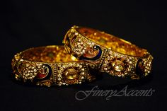 $40 SKU:100-3 D  Bangle Size:2.6 BUT FITS 2.8 AS ITS SCREW TYPE Peacock Stone Rich Bangle