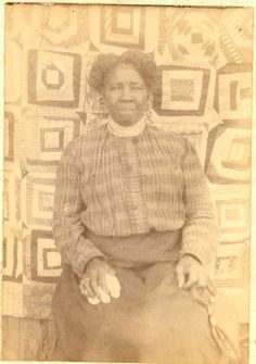 African american woman with her Quilt, c.1910