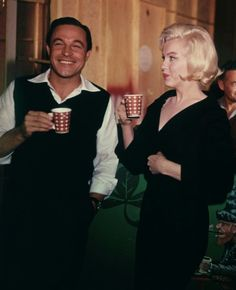 Marilyn Monroe with Gene Kelly on the set of Let's Make Love, 1960.