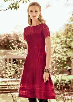 The fit and flare dress, with a flair for after-dark. Rich red Rubin knit, an easy wearing neckline and sleeves plus a chic short length create a style that's easy to express yourself in. Dotted lace around the yoke and hem bare a bit of skin ever so elegantly. Pair with gold or silver Swarovski jewelry.