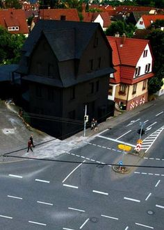 This guy loves the colour black so much he painted his whole house pitch black. Only in Germany.