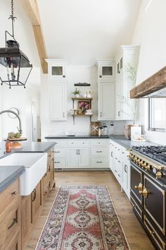 Refined, rustic kitchen with exposed wooden beams, hanging lanterns, painted white brick, oven range in mountain home - Studio McGee Design Modern Kitchen Design, Interior Design Kitchen, Kitchen Decor, Kitchen Ideas, Kitchen Rustic, Kitchen Tables, Interior Ideas, Kitchen Runner, Kitchen Contemporary