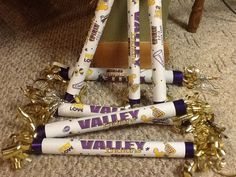 School spirit sticks!   Great and easy take any paper roll to size.  Make it tight.  Tape it good then cover with printed paper. Add ends with hot glue!