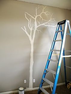 Painting trees on walls #diy. Perfect to add a simple decal to your living room, office or kids room.