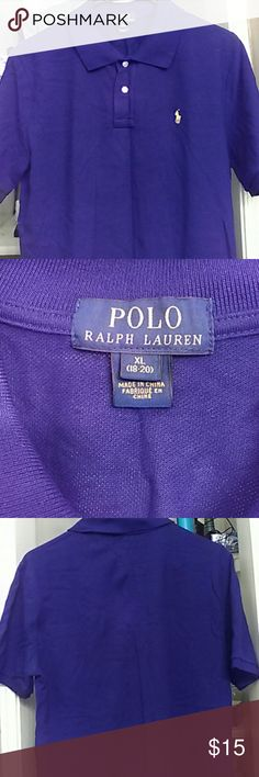 Boys Ralph Lauren polo shirt Color is dark blue and has a yellow logo on the front. The shirt is in excellent condition and the color combo makes the logo really stand out. Fits like a men's small Polo by Ralph Lauren Shirts & Tops Polos