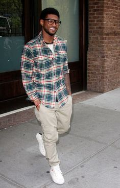 Usher looking quite stylish in a plaid flannel shirt.