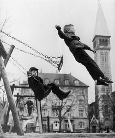 Back in the day when swings were boards!!  Remember lots of jumping out!