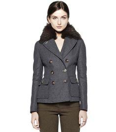 Sleek peacoat with fur trim.