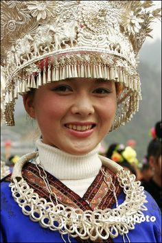 Amazing headgear - A woman of the Miao ethnic minority wearing traditional ethnic costumes