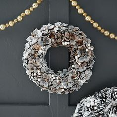 Pine away. These wreaths are handcrafted from real pinecones for a woodsy, rustic look. | West Elm