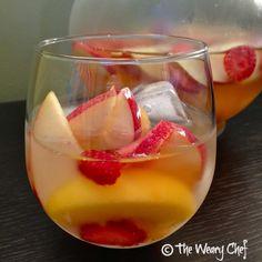 Easy Strawberry-Peach White Sangria Recipe: 1 apple, 12 oz peaches frozen, 2 handfuls strawberries, 1/2 cup gold rum, 1 750 ml white wine sweet.