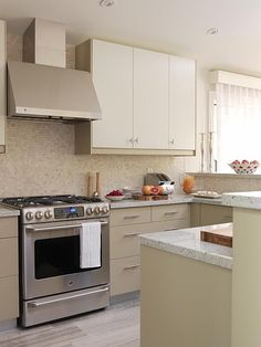 creamy white kitchen cabinets, marble beveled countertops and