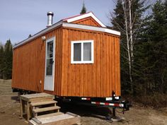 Here is a tiny house with the 1 door on the side of the house design. Unfortunately this one does not have a bathroom.