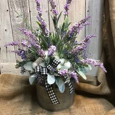 Cotton and Lavender Floral Arrangement in galvanized tin bucket- In creating this arrangement I used cotton and lavender stems with lambs ear as my primary and added some wispy green spring vines and