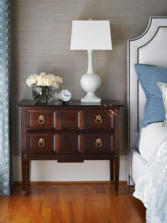 A solid wood end table brings a touch of traditional sophistication to this sleek, contemporary bedroom.