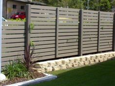 Slat-screen fencing for deck privacy - this is the idea for our back yard & vege terrace - painted in [Aust] Dulux 'IronStone'