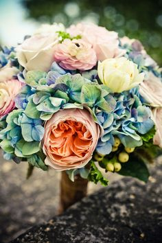 I like how the hydrangea fills out the bouquet. This would be good for table flowers. Except probably prefer white hydrangea, not this blue/purple. I also really like the peachy, creamy white, pink colors.