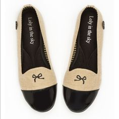 Tan & Black Flats Vegan friendly materials. Padded inside for comfort & lined with natural materials. Website says to order half a size up. I'm normally a 8 & the 8.5 fits me perfectly. Worn once, very comfortable.  Make me an offer!✨ Loly in the Sky Shoes Flats & Loafers
